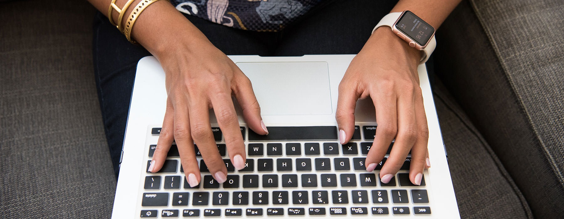 lifestyle image of a person typing on their laptop